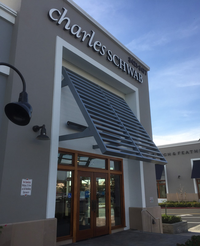 Charles Schwab Metal louvered Architectural Awning Metal Ontario Inland Empire San Bernardino County and Los Angeles Sign Makers Black Coffee Sign, Awnings and Architectural Awning Fabricators Southern California.